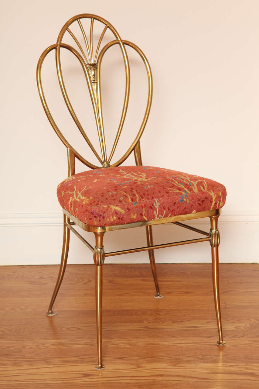 Unusual Hepplewhite style model with shield shaped back; the Clarence House epingle upholstered seat over the tapering legs joined by stretchers.