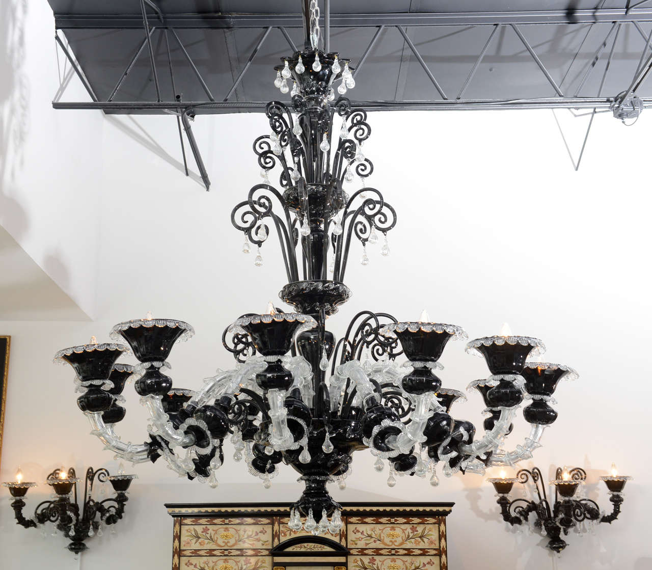 Chandelier with scrolling arms, pendants and drops.