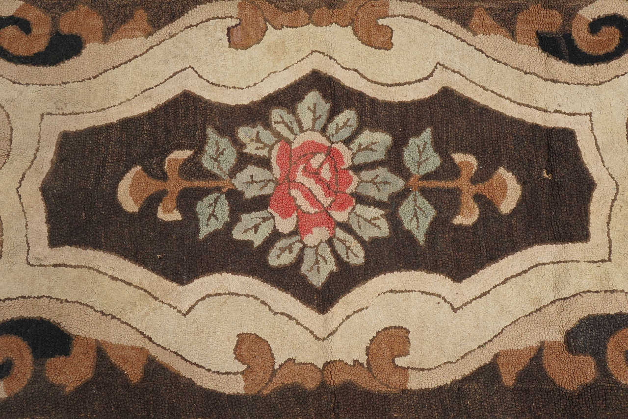 Folk Art American Hooked Rug with Floral Decoration For Sale