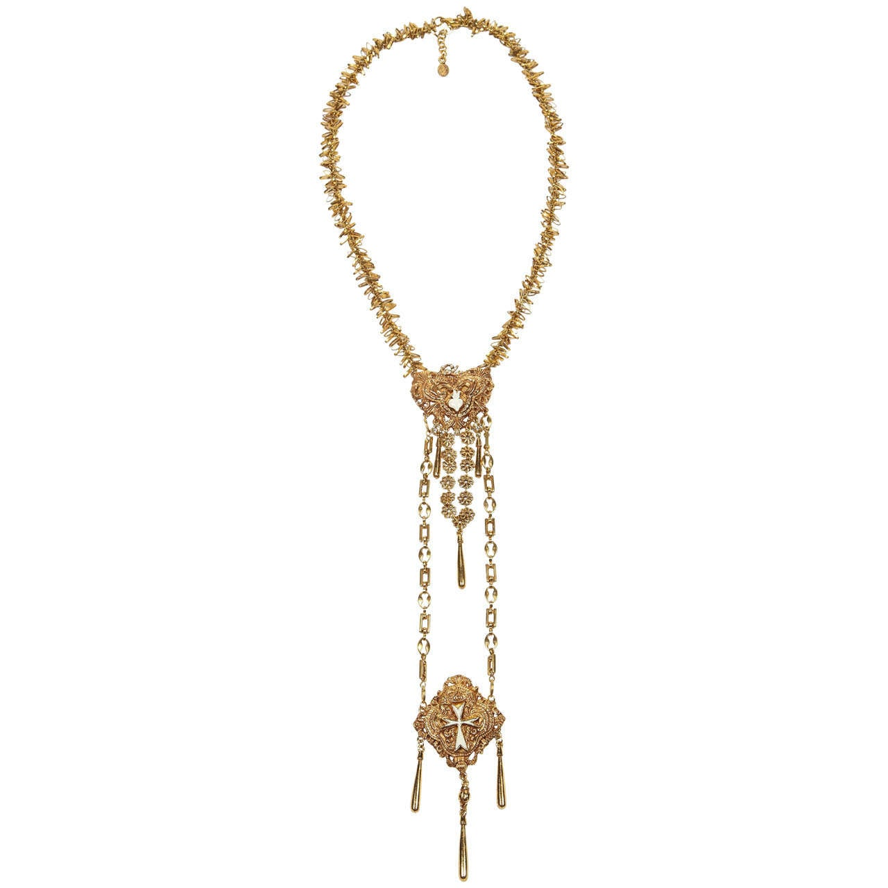 A striking double drop necklace by Christian Lacroix of gilt metal, enamel details in each pendant and rhinestone accents, including the CL at the top of the first pendant. Nicely detailed with various types of chain, including a fringed chain at