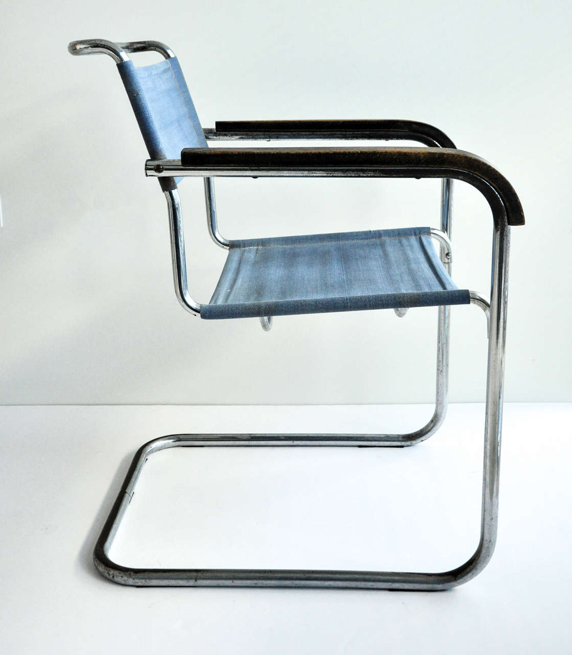 A Cantilevered Tubular Steel Armchair With Wood Armrest Originally Designed  In 1928 For Thonet By The