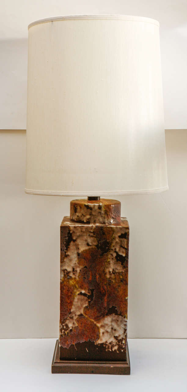 Interesting studio pottery lamp with shade.