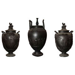 A Large Scale Wedgwood Black Basalt Three Piece Garniture