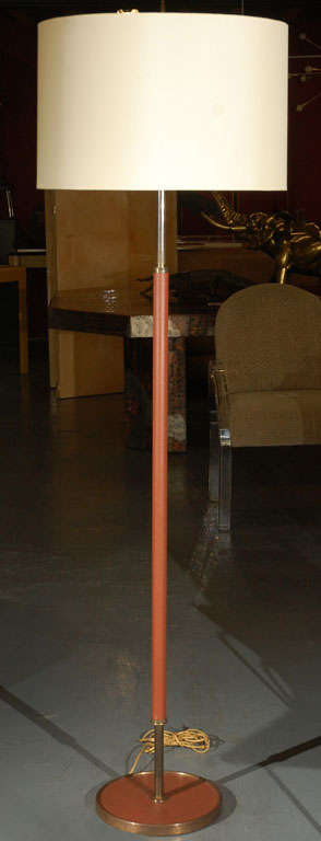 1950s brown leather with bronze detail floor lamp by Jacques Adnet.