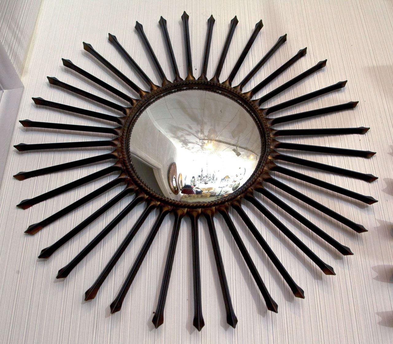 Metal arrow sun ray mirror.