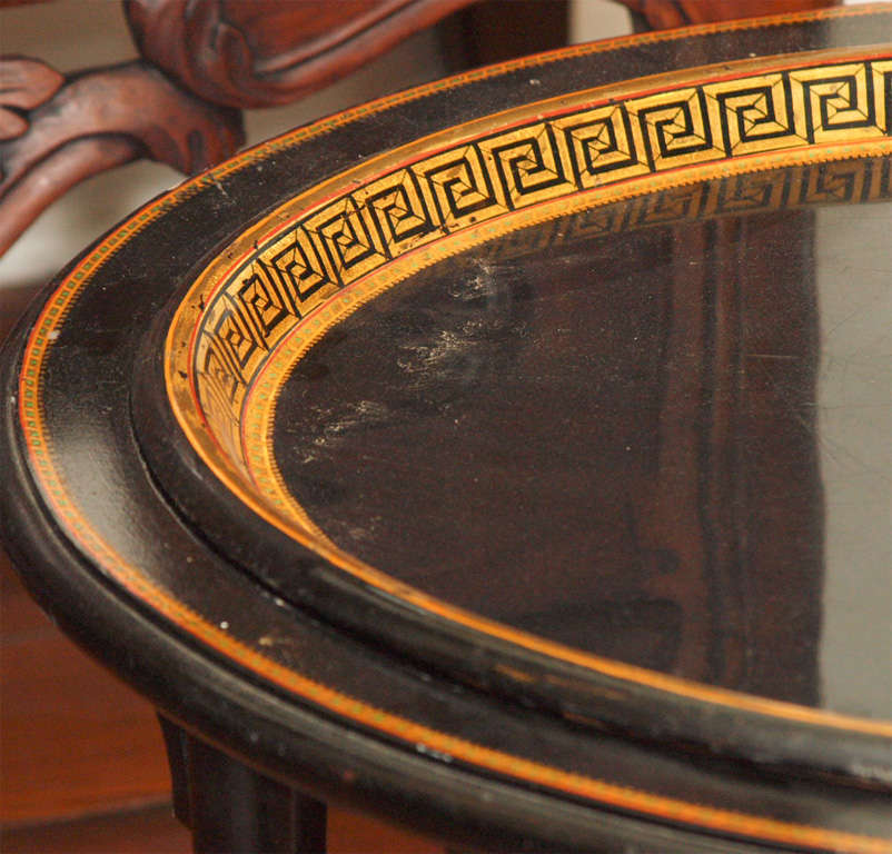 French Tole tray with gilt and painted greek key decoration and later carved wood and painted base