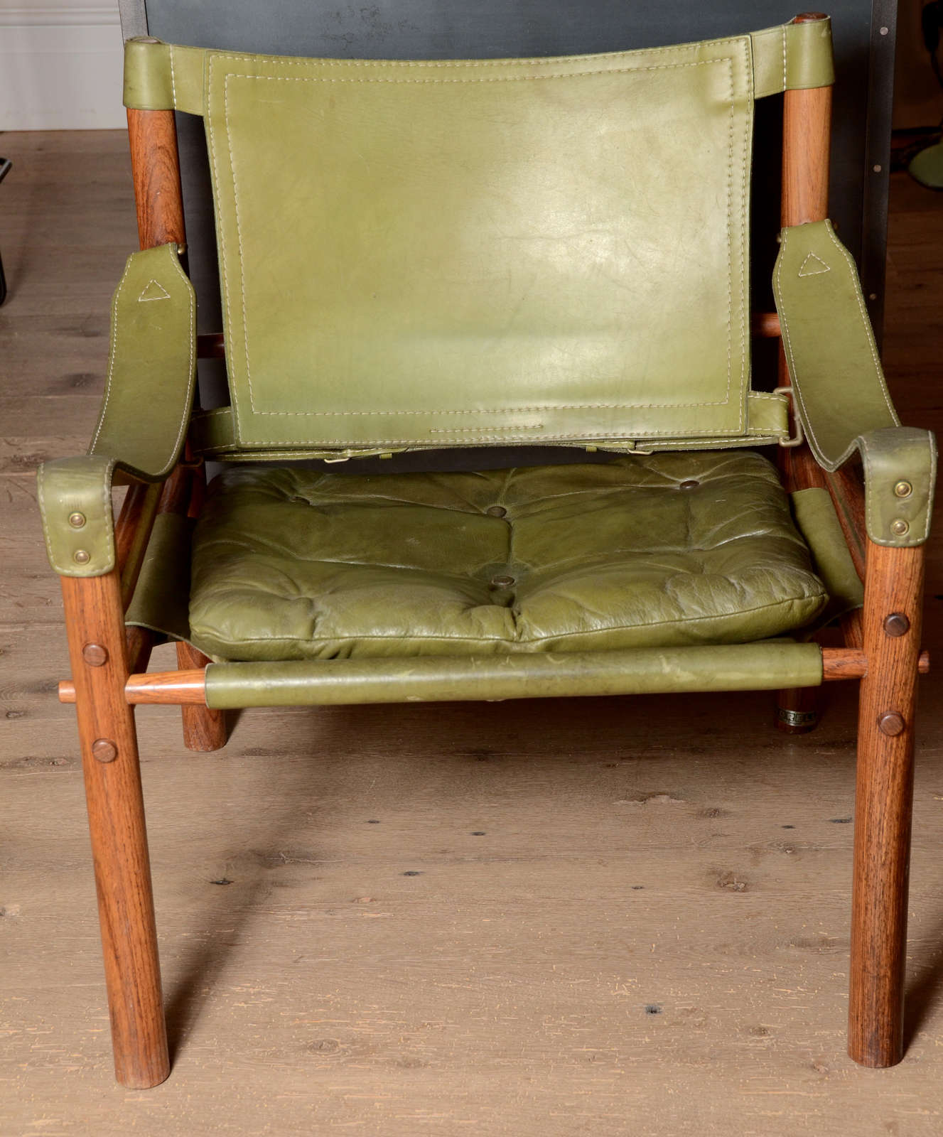 Stunning pair of Mid-Century Arne Norell Safari chairs in light olive green original leather