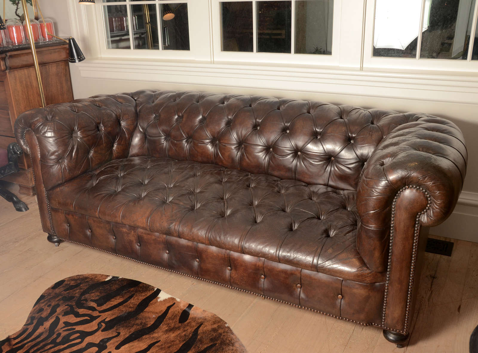 French Dark Brown Chesterfield Sofa With Original Leather Nailhead Detailing Along The Arm Rail And