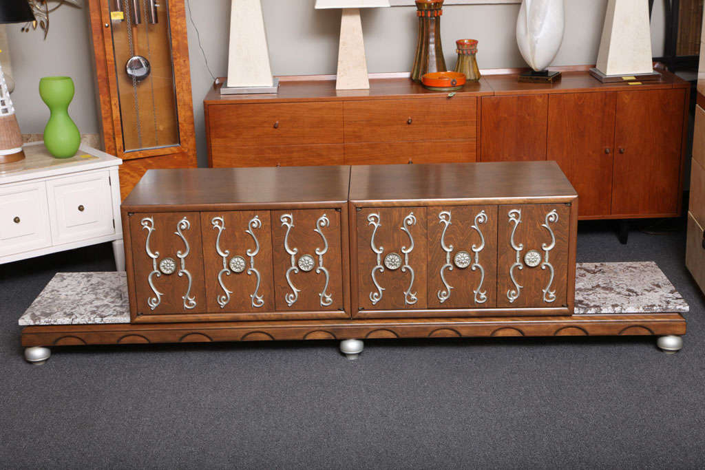 REDUCED FROM $2,850. Definitely with James Mont inspirations and Renzo Rutili as well, this exquisite credenza with movable cabinets and marbles is a delight. Supporting two cabinets and marbles, the molded and shaped walnut base with turned bell