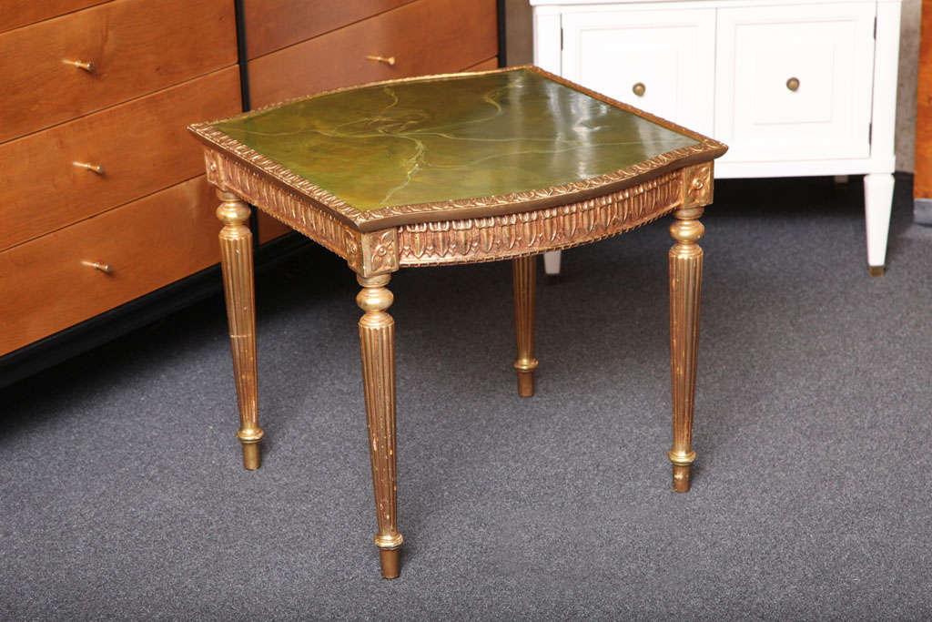 Delightful and quite nice 1960s Louis XVI style giltwood side table with a painted faux marble top. Very lovely