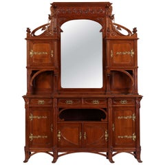 An Italian Carved and Gilt-Metal Mounted Sideboard Cabinet
