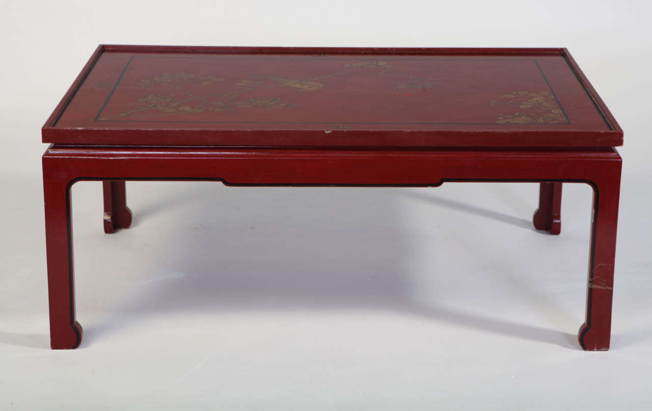 A Square Red laquered  Coffee Table with a 19'century chinese decorated screen on four legs of the XX' century.