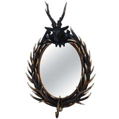 Staghorn Black Forest Oval Mirror