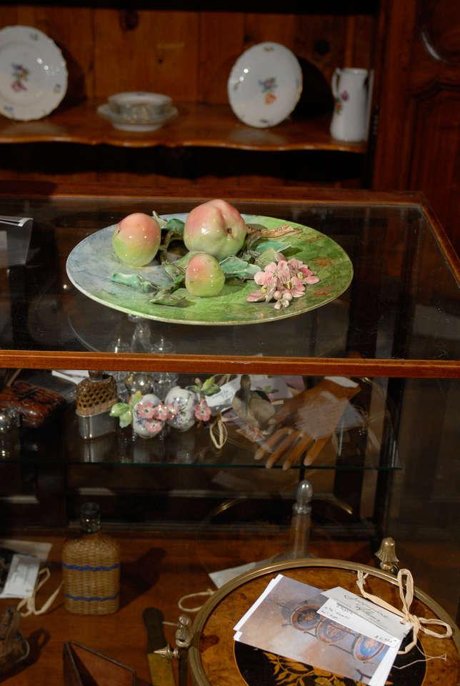 Decorative antique Longchamp Majolica plate with apples & flowers, circa 1880.