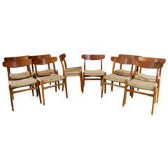 Ten Hans Wegner Teak, Oak and Cord Dining Chairs