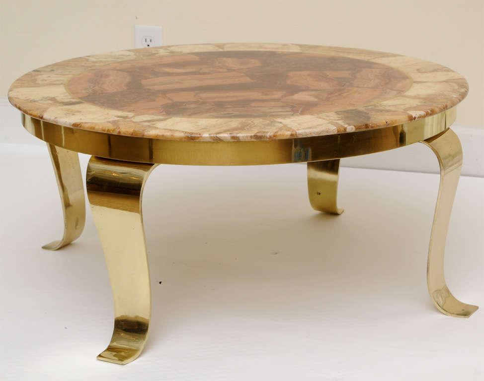 "This signed onyx marble and polished brass cocktail/ side table resembles beautiful earthy agate. This was made in Mexico in the 60's and is signed on the front of the table and has ""hencho en Mexico"" on the bottom. The splayed legs are all polished"