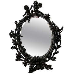 Large Carved and Ebonised Walnut Mirror