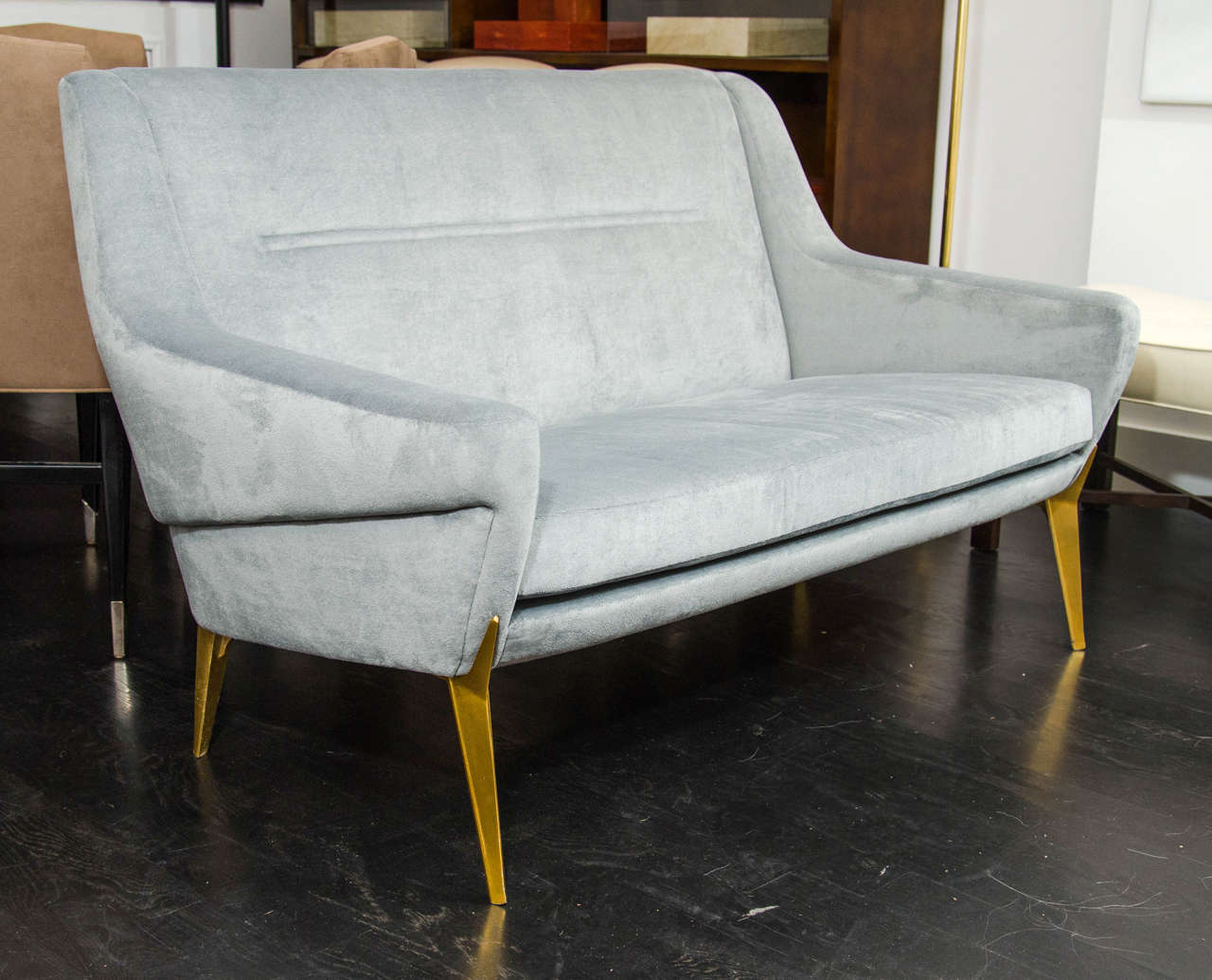 Vintage settee by Charles Ramos with gilt aluminum legs and fresh velvet upholstery.