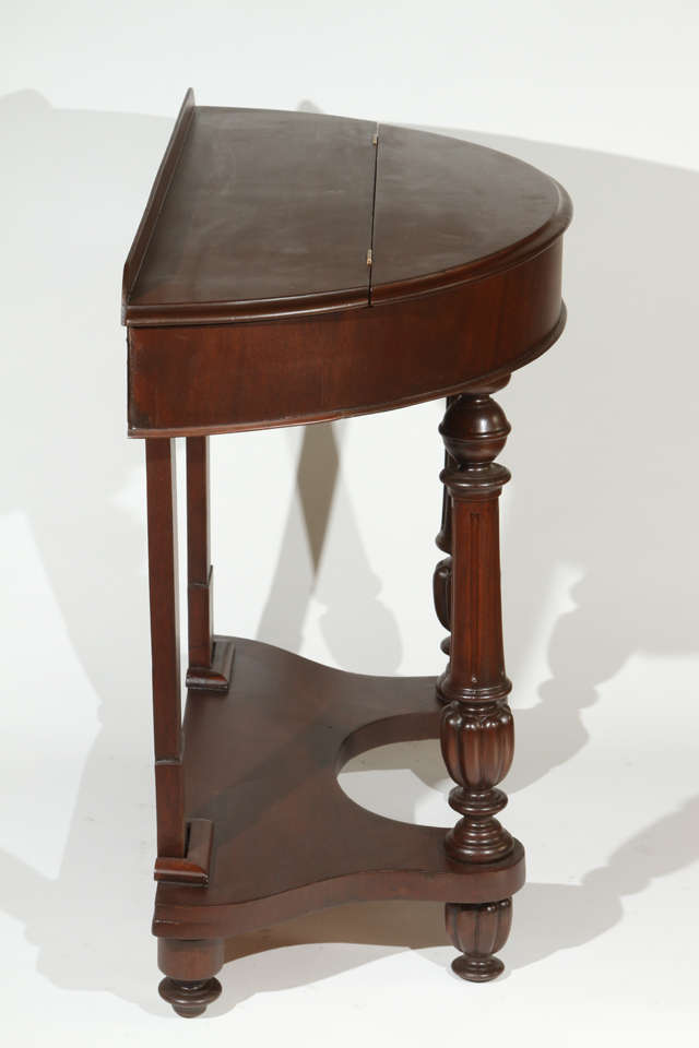 1940s Half Circle Mahogany Side Table With Turned Front Legs And Top Storage Compartment Fully