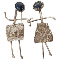Pair of Modernist Silver and Lapiz Pins