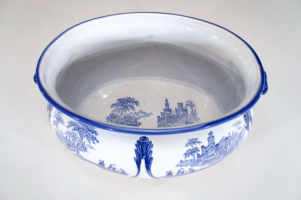 This wonderfully large and graceful porcelain foot bath is decorated in the classic blue and transferware palette, embellished with blue trim and and handles. A great piece for display and even better as a centerpiece on a large sideboard or table,