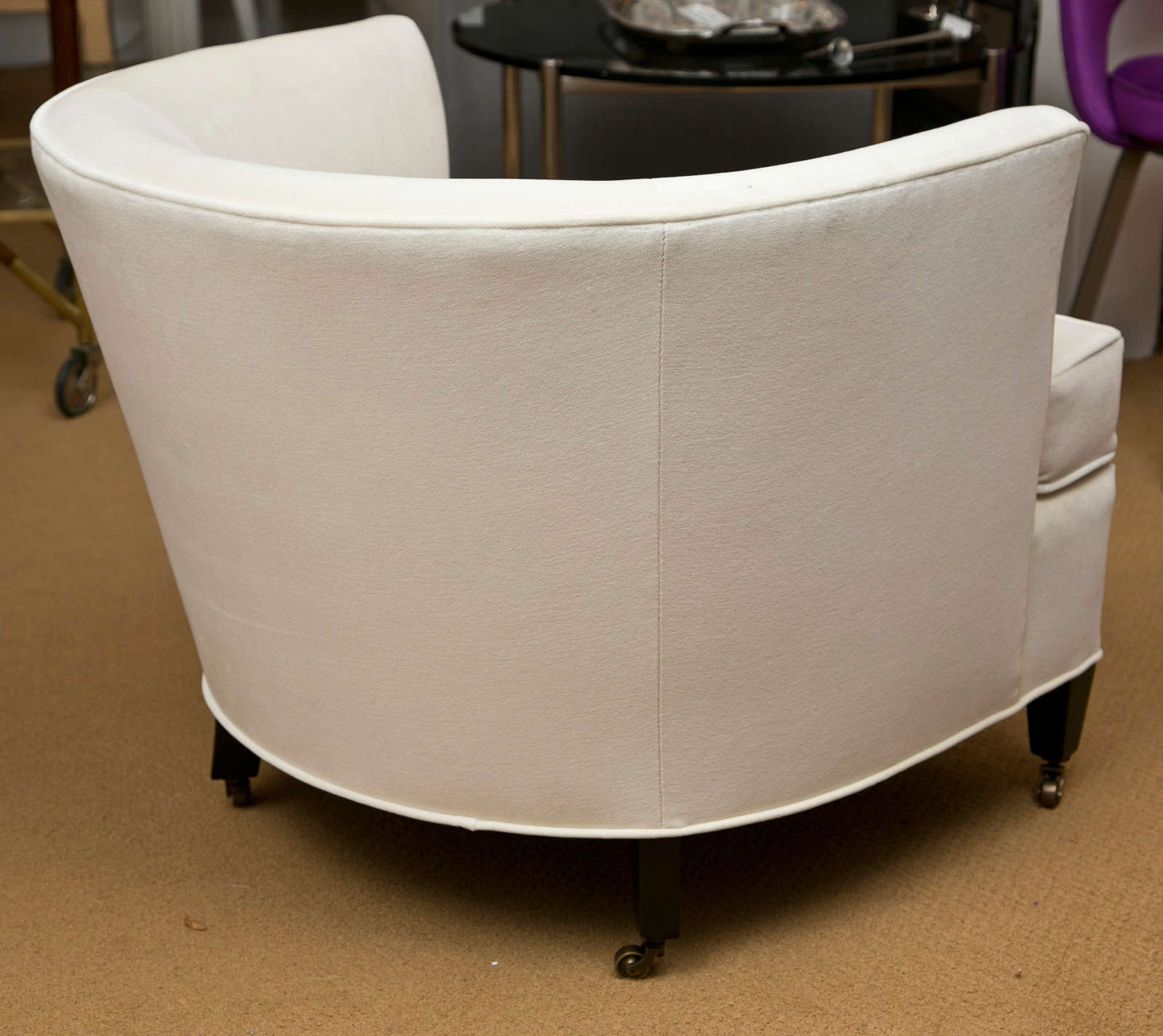 Mid 20th Century Pair Of Tub Chairs With Casters For Sale