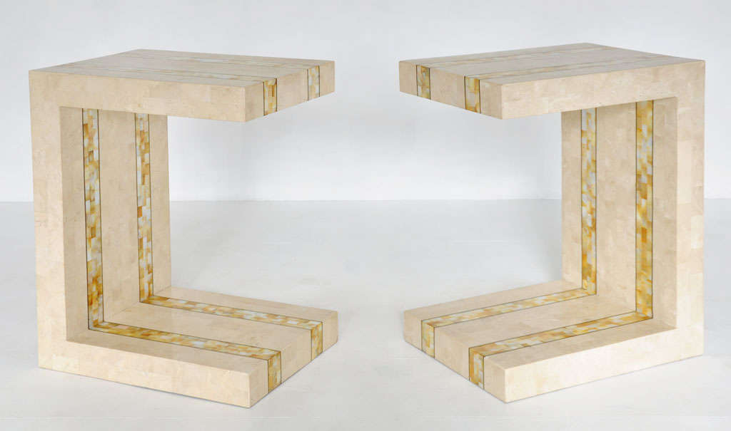 Pair tessellated stone end tables by Maitland-Smith.  Brass inlay with tessellated mother of pearl detailing.  Made in Philippines in factory along side Karl Springer designs.