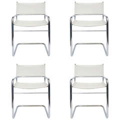 Set of Four Midcentury Chrome and White Pleather Chairs