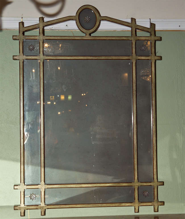Green paint with gilt highlights pier mirror, with glass stars.  Stamped Jansen.