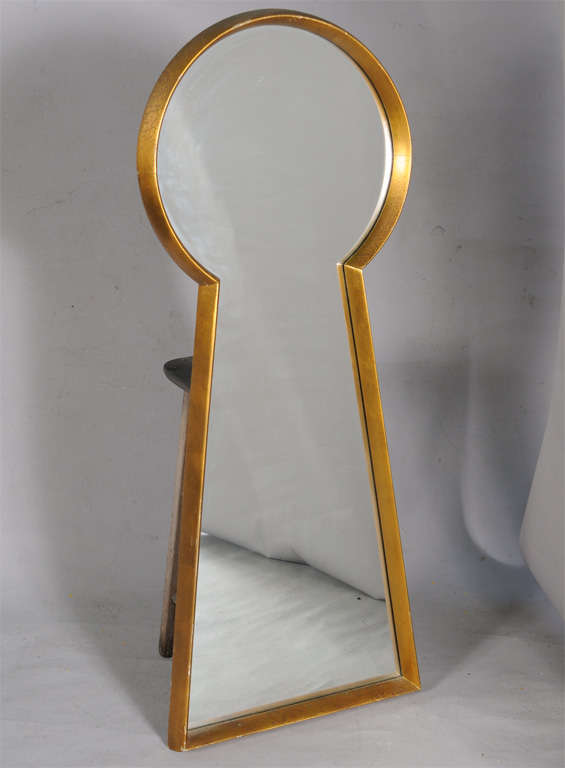 Unusual mirror, having a giltwood frame in the form of a giant keyhole.  From the estate of noted pin-up artist Peter Driben (American, 1903-1968), who often illustrated his subjects inside the silhouette of a keyhole.  Wikipedia page for Driben: