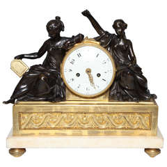 A Louis XVI Period Antique French, Patinated and Dore Bronze Mounted Figural Clock