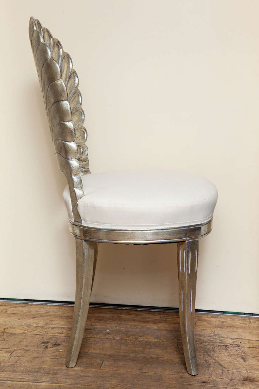 An Italian Shell Back Carved And Silver Leafed Chair At