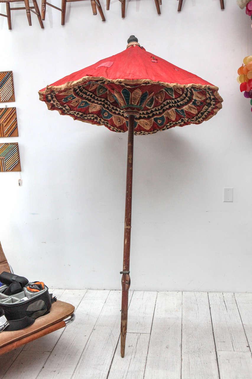 Charming and beautifully detailed cloth umbrella.