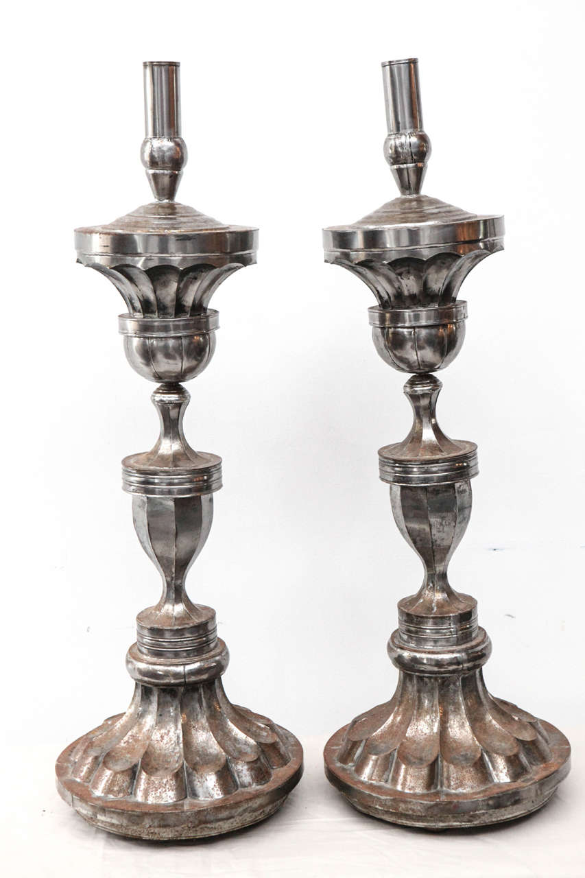 "Large metal candle holders with 1 5/8"" opening."