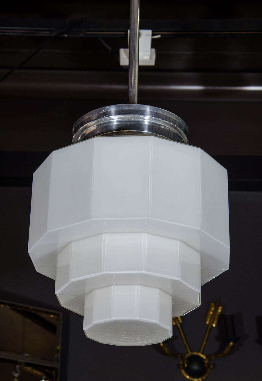 Pair of art deco light fixtures with machine age style design the fixtures are comprised