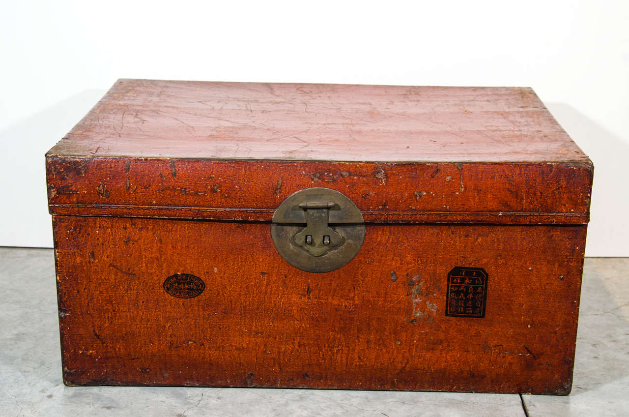 A nicely worn parchment leather trunk with two distinct chop markings on front. With original hardware. From Shandong province, circa 1900.
