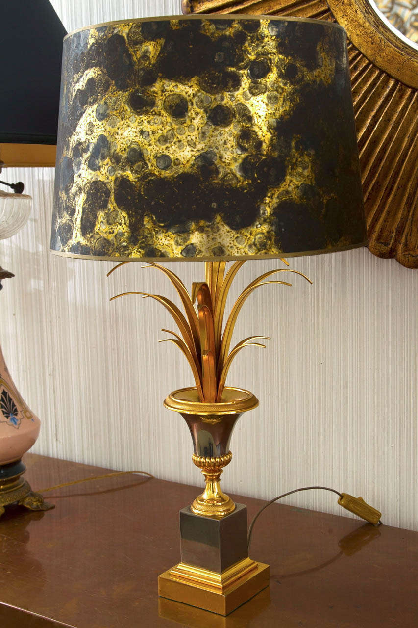 Bronze and chrome urn form on plinth base lamp with foliate decoration, original shade