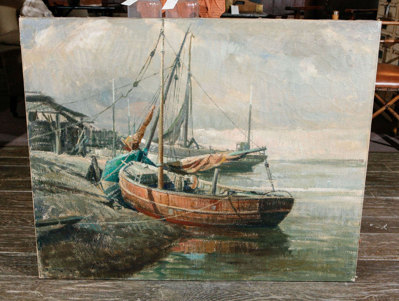 Early 20th century Belgian oil on canvas of boats at the shore. (Unframed).