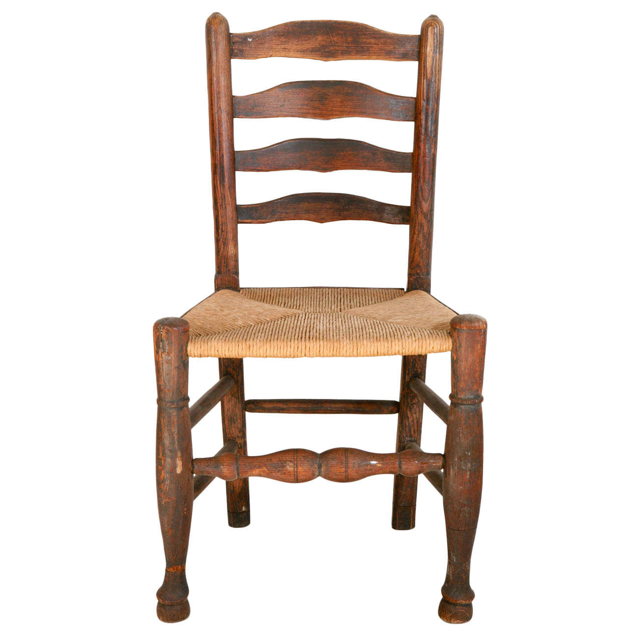 Turn of the century ladder back and woven seat chair at Ladder back chairs