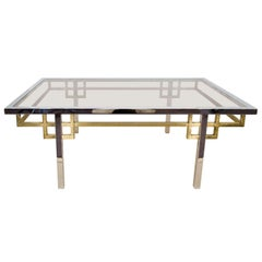 A Mid Century Brass, Chrome, and Glass Coffee Table