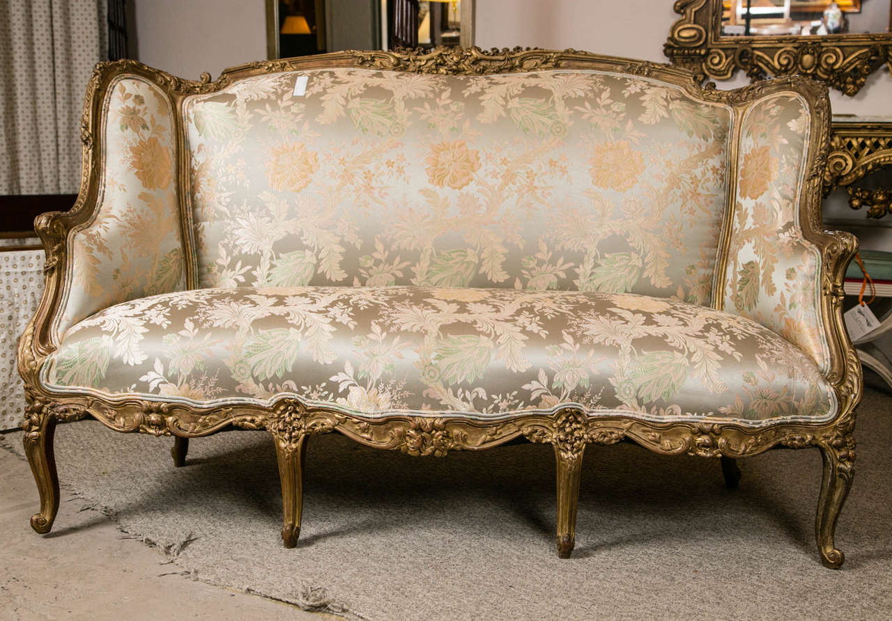 This quality Louis XV Style Carved French Sofa by Jansen will light up any room setting
