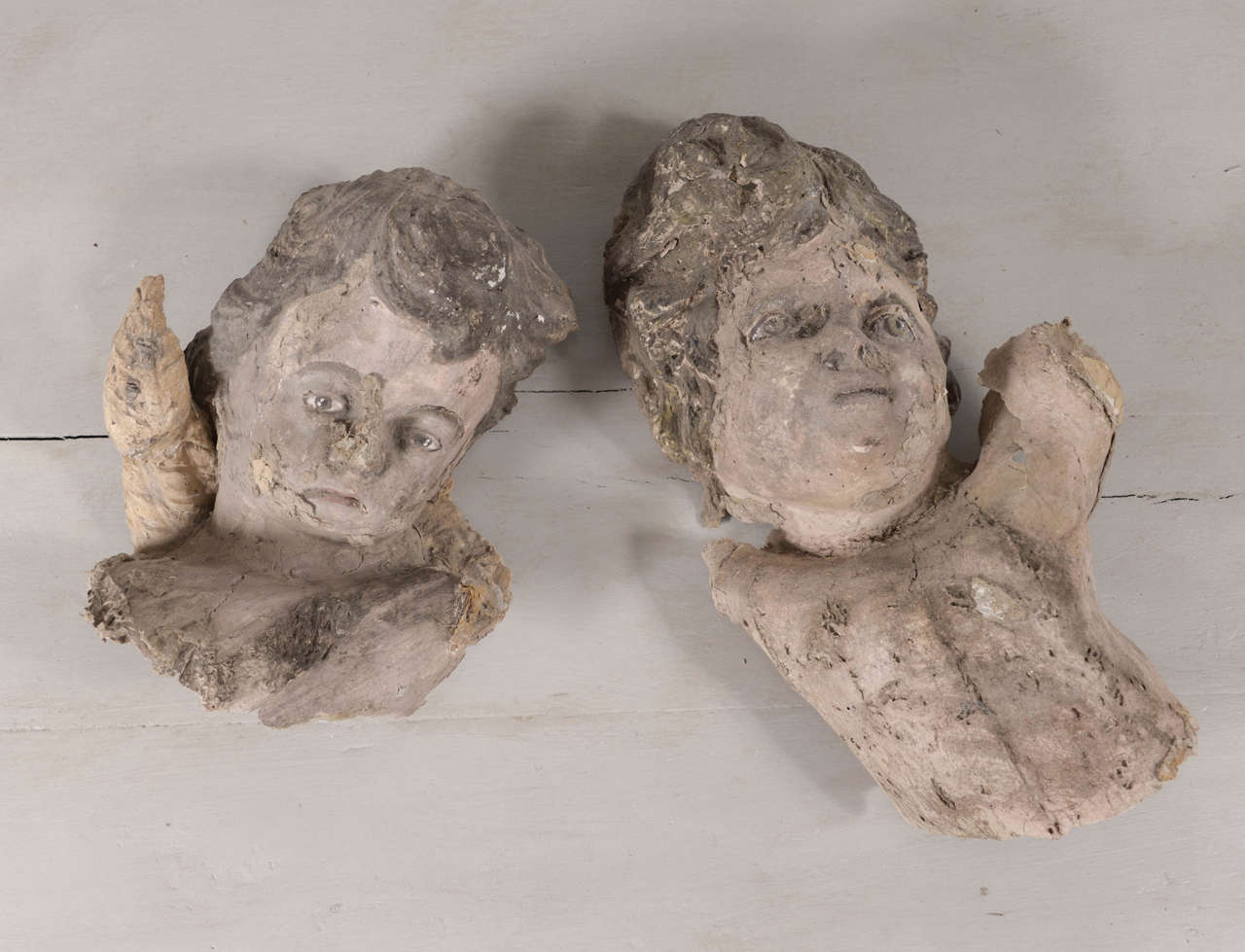 Pair of papier mâché angels. Uncommon, well-preserved 18th century sculptural fragments.