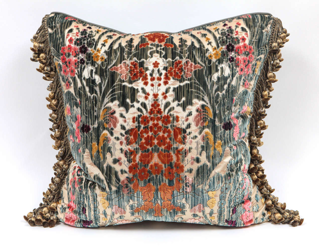 Pair of world-renowned and prominent fabric maker Luigi Bevilacqua Italian silk velvet pillows. Decorative tassel silk trim has been applied to finish the edges. These pillows are sold as a pair.