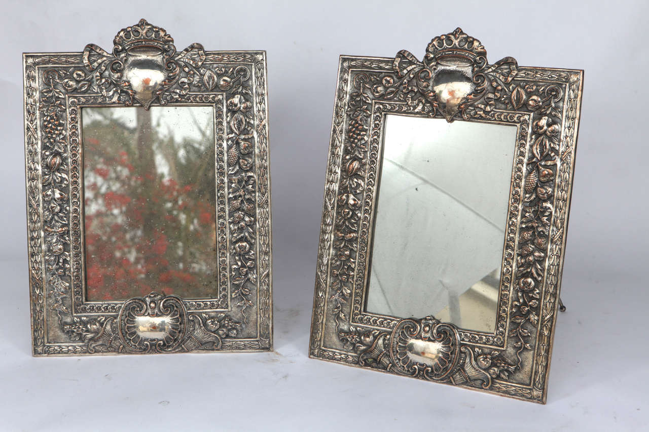 Pair of late 19th century English silver on copper standing or hanging mirrors.