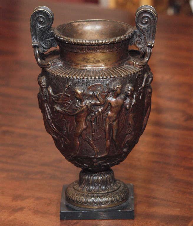 Pair of bronze on black marble bases Grand Tour vase