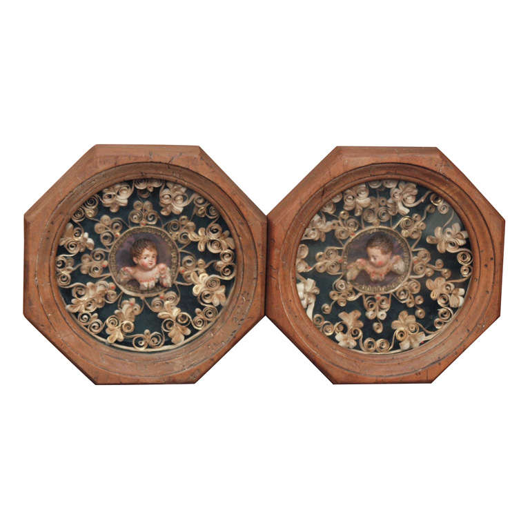 PR OF SHADOWBOXES W/ ROLLED PAPER AND POLYCHROME PUTTI HEADS