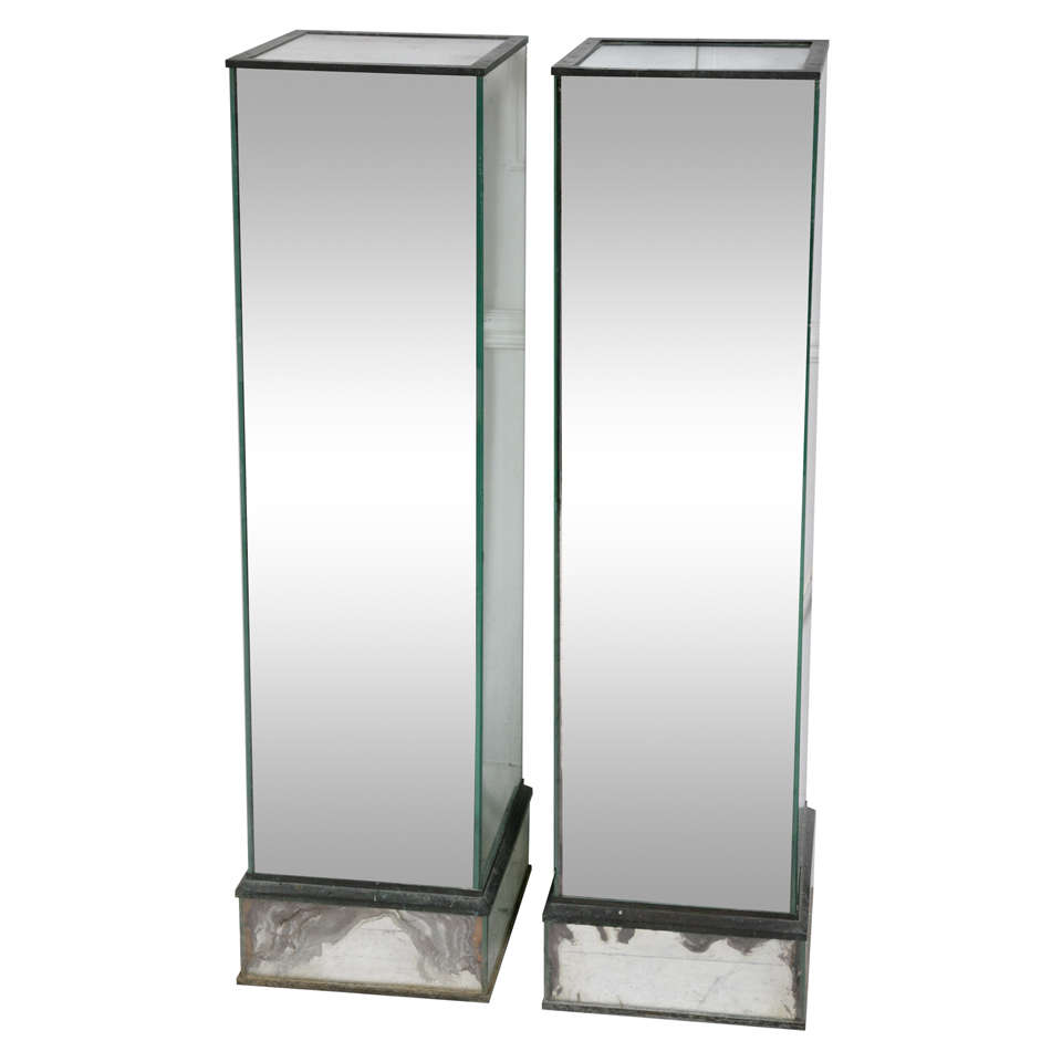 A pair of mirrored columns, plints at 1stdibs