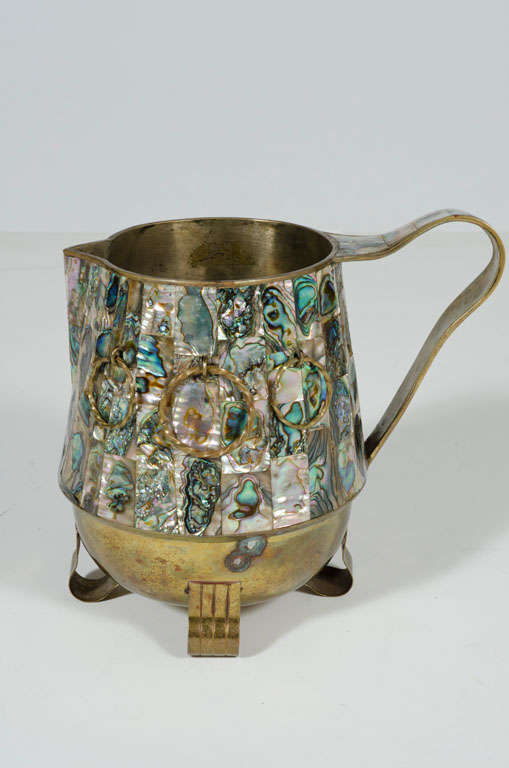 A marvelous water pitcher overlaid with abalone shell and twisted brass rings by Salvador Teran. Mexican, circa 1950.