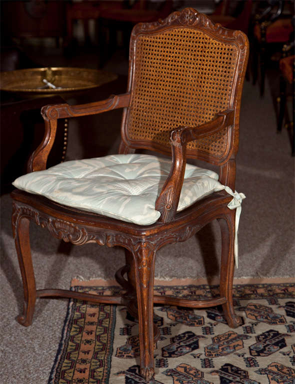 Pair of French Provincial Caned Armchairs at 1stdibs