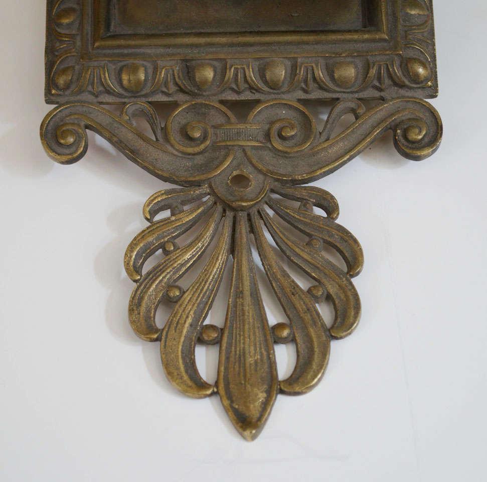 Cast Pair of Antique Bronze Two-Arm Sconces For Sale
